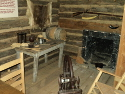This exhibit shows what the inside of a typical log cabin home would have looked like.