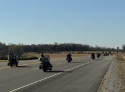 Riders continue on the Trail of Tears route down Highway 64..