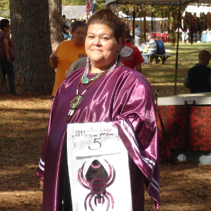 Yalonda Moore wears regalia featuring the water spider.